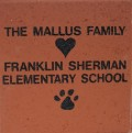 Engraved mallus family logo brick